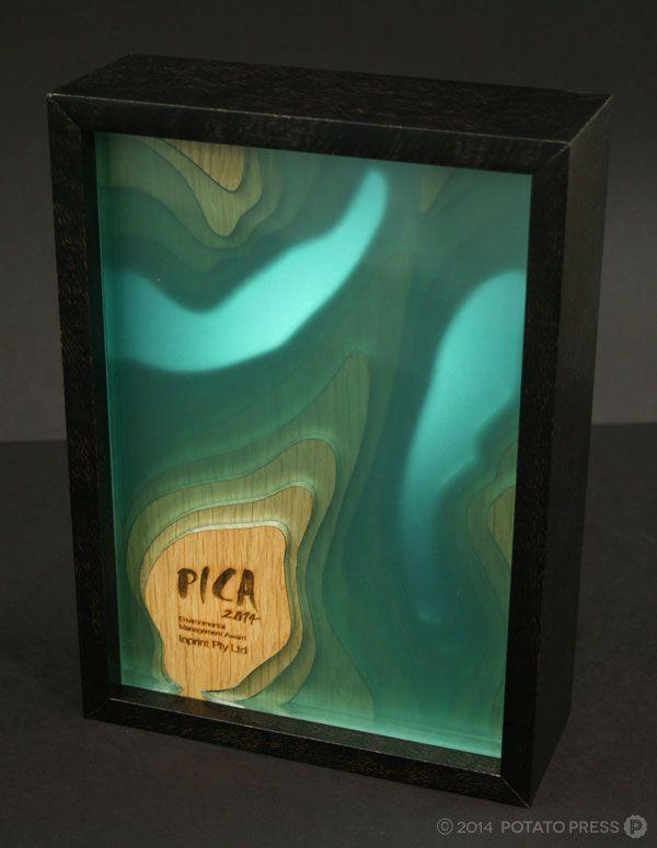 laser cut, wood plus acrylic.... layers