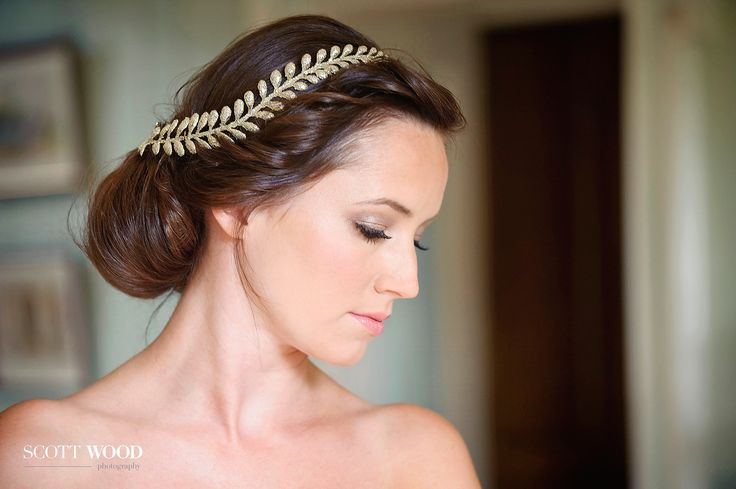 A simple hair jewel and elegant chignon accentuate the beauty of this bride at Island Hall Cambridgeshire UK