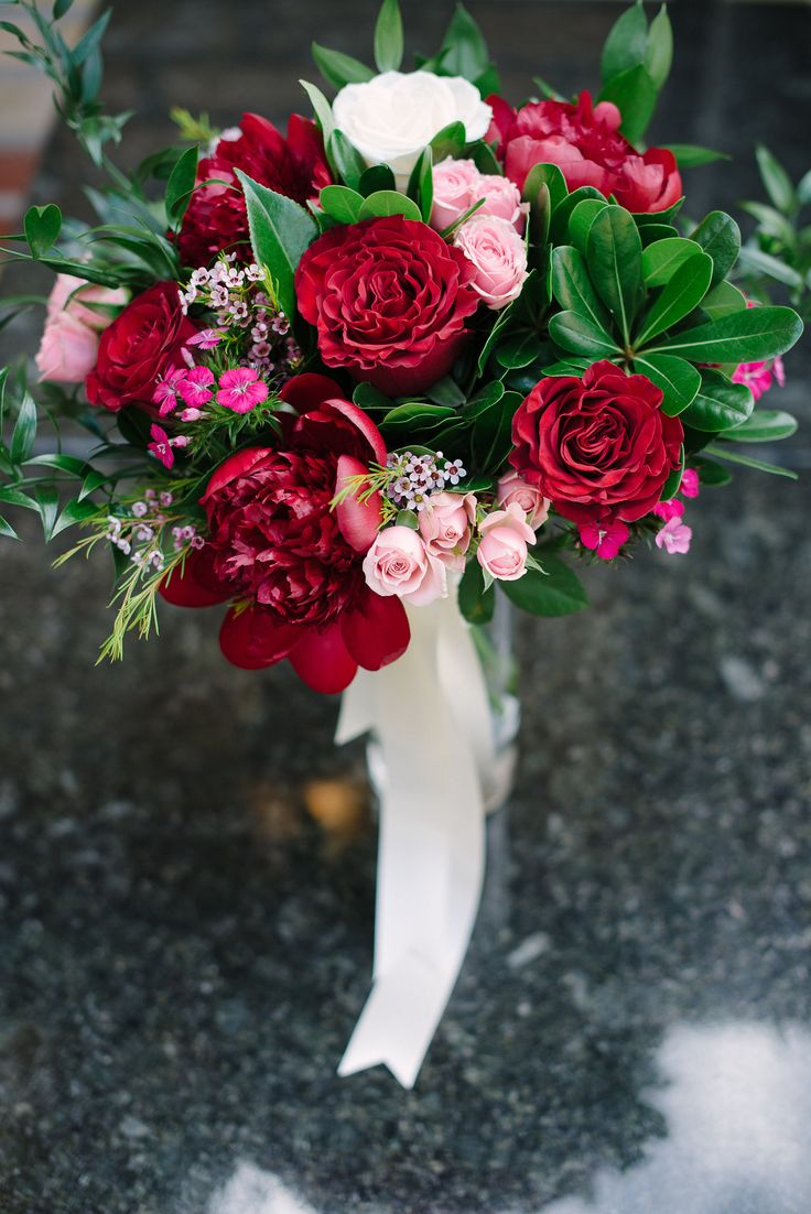Bridal bouquet featuring Hearts garden roses, blush spray roses and burgundy peonies. Photo @abbyplusdave  Flowers by Janie- Calgary Wedding Florist  www.flowersbyjanie.com