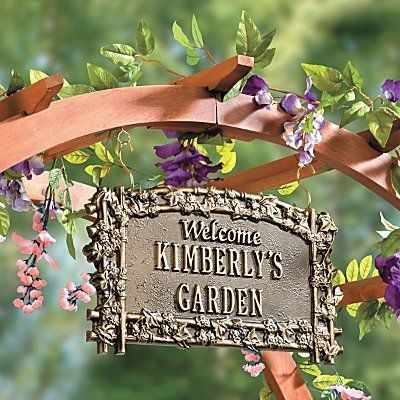 """Hanging Personalized Garden Sign - ANTIQUE COPPER - Improvements by Improvements. $49.99. Personalization on the custom plaque measures 1-1/4"""" high. Custom plaque is rust-free cast aluminum to last for many years. Hanging Personalized Garden Sign can also be used indoors: """"Welcome Lilli's Room"""" or next to your front door: """"Welcome Lakeview Cottage"""". Personalization on the custom plaque measures 1-1/4"""" high. Hanging Personalized Garden Sign can also be used indoors: """"Welcome ..."""