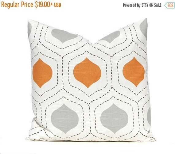 Decorative throw pillow covers in gorgeous shades of burnt orange and gray on IVORY (it photographs more white than it is). The stitched lines on the print are dark brown. Designer 100% home decorating weight cotton with a slub (linen) like appearance. This listing is for one cover. These are made for 20 x 20 pillows and they are the very last two I will have in stock.  The backs of the covers feature the same fabrics as the front and have an envelope closure for easy access.  All images ©…