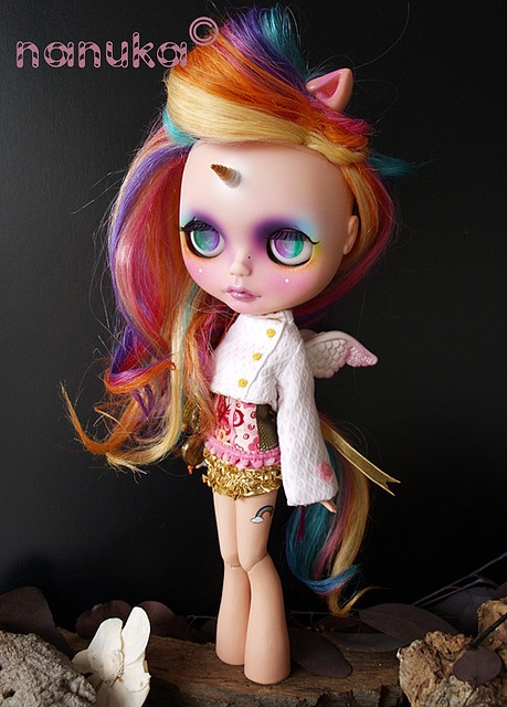 Blythe dolls are weird. Period. But this one was all fixed up to have My Little Pony hair, legs and coloring. The chick that recreated her is an artist. This doll is cool.