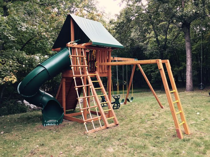 Here's our Ultimate wooden swing set, with three big upgrades: a horse glider swing for two, a set of monkey bars and a spiral tube slide. How fun!