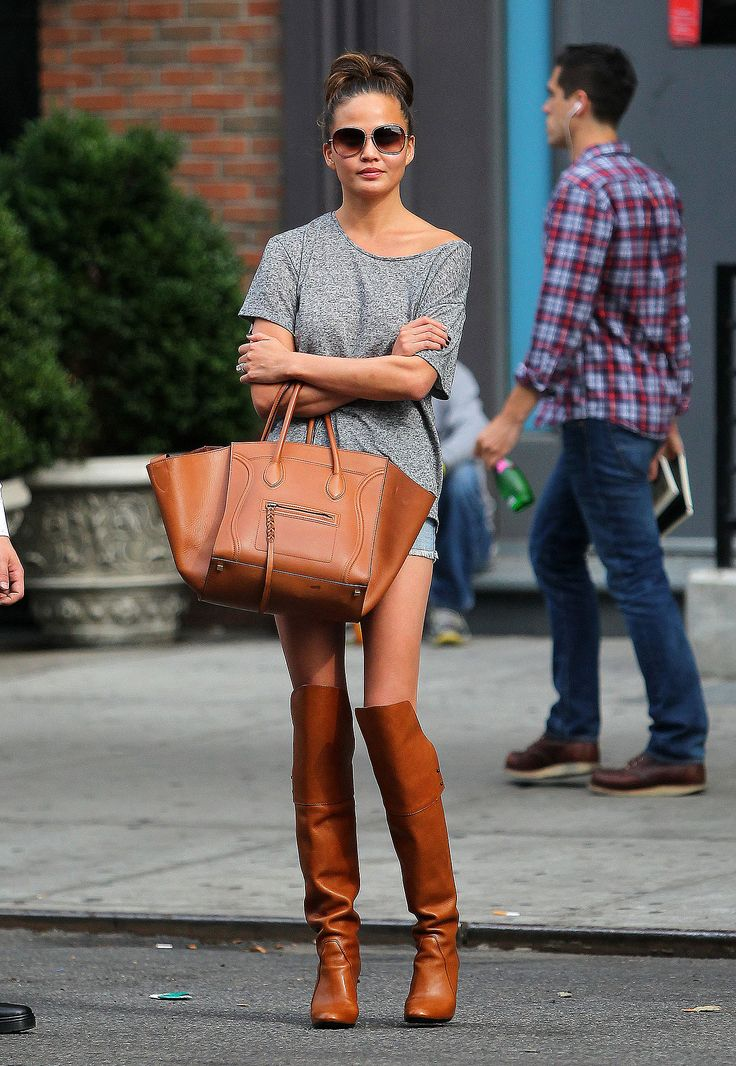 Chrissy Teigen wasn't afraid to work a matchy-matchy look when she paired tan leather over-the-knee boots with a coordinating Céline luggage tote in NYC.