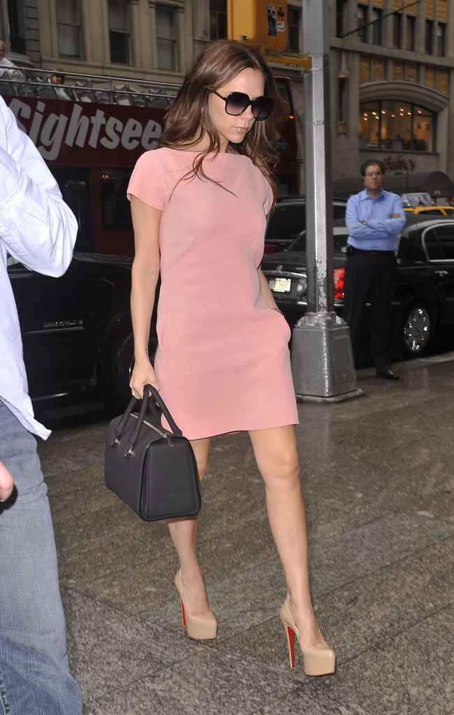 Victoria Beckham leaves the Four Seasons Hotel and takes her new daughter Harper shopping in New York during fashion week. The former Posh Spice wore Christian Loboutin Daffodil 160 platform pumps with a six and a half inch heel.