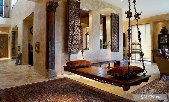 Use rich wooden swings inside your home as a fashion statement. Use a dark wood polish like coffee brown or dark mahogany for your swing-set and throw in some cushions in some attractive fabrics like faux silk. If your living room has metal work in it, then experiment with colors like maroons or oranges for a bright look. . #interiorstyling #interiordesigner #interiors #interiordecor #interior4all #interiorandhome Image Source:  https://in.pinterest.com/pin/539869074054302403/