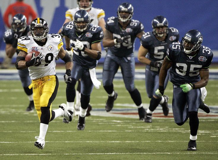 SB XL:  FEB. 5, 2006: Pittsburgh Steelers running back Willie Parker makes a 75-yard touchdown run as he is chased by Seattle Seahawks, from left, LeRoy Hill (56), Michael Boulware (28), Bryce Fisher (94), Lofa Tatupu (51) and Etric Pruitt (35) during the third quarter of Super Bowl XL in Detroit. Despite trailing the Seahawks in most offensive categories, the Steelers capitalized on big plays to win 21-10, joining the San Francisco 49ers and Dallas Cowboys as teams with five Super Bowl…