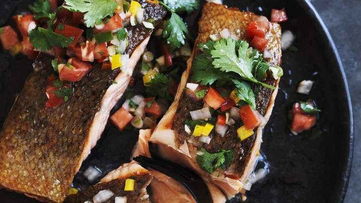 Crispy-skinned barbecue salmon with pebre salsa.