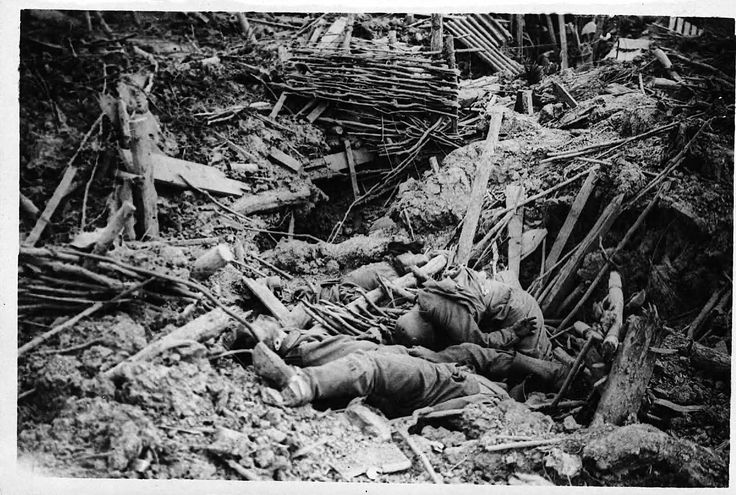 Smashed up German trench on Messines Ridge with dead - Tunnel warfare