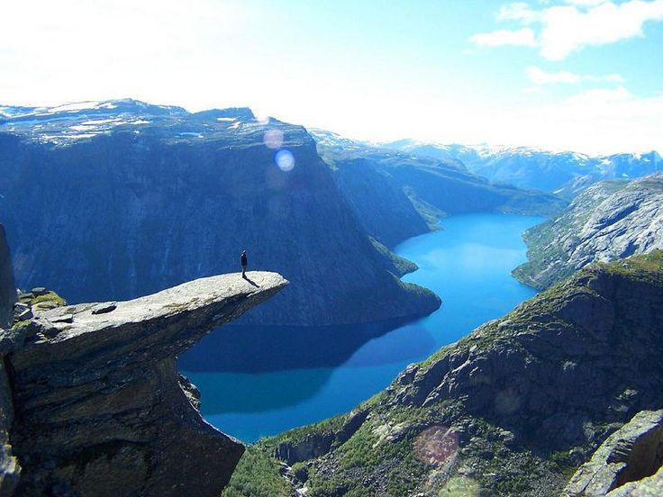 Preikestolen or Prekestolen, also known by the English translations of Preacher's Pulpit or Pulpit Rock, is a steep and massive cliff 604 metres (1982 feet) above Lysefjorden, opposite the Kjerag plateau, in Forsand, Ryfylke, Norway.