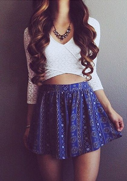 Model in white sheer lace crisscross crop top and blue skater skirt