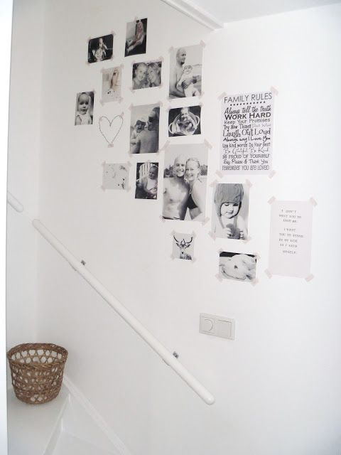 Loose gallery wall. taping pictures to walls with masking tape, easily changed out.