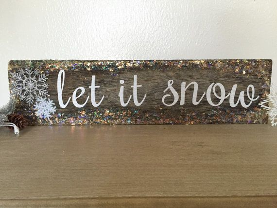 "Rustic, barn wood ""Let it Snow"" sign."