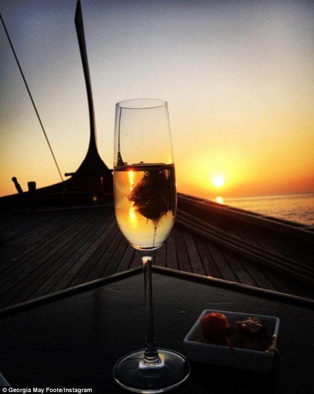Bubbly fun:As their evening drew to a close, the loved-up pair watched the sunset with a ...