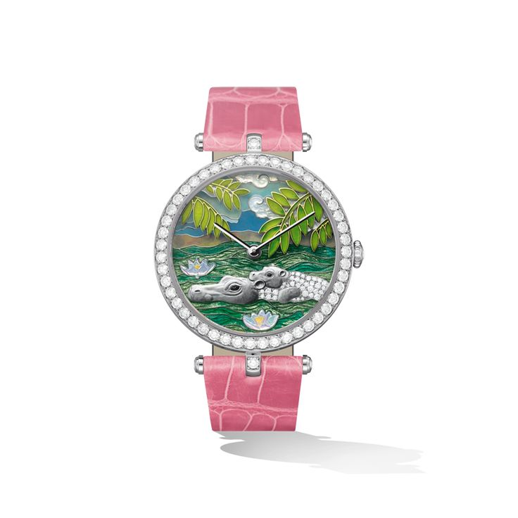 A series of 4 watches celebrates the exuberant vegetation and wildlife of Africa, as seen from the basket of Jules Verne's balloon.  Two hippopotami play in a river, the inlaid mother-of-pearl brings an illusion of life to the lotus flowers that blossom across the surface of the water.  Diameter: 38mm, Strap: Alligator, Movement: Mechanical Piaget 830P