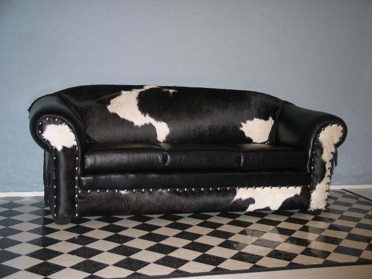 Black white leather and cow hide sofa.