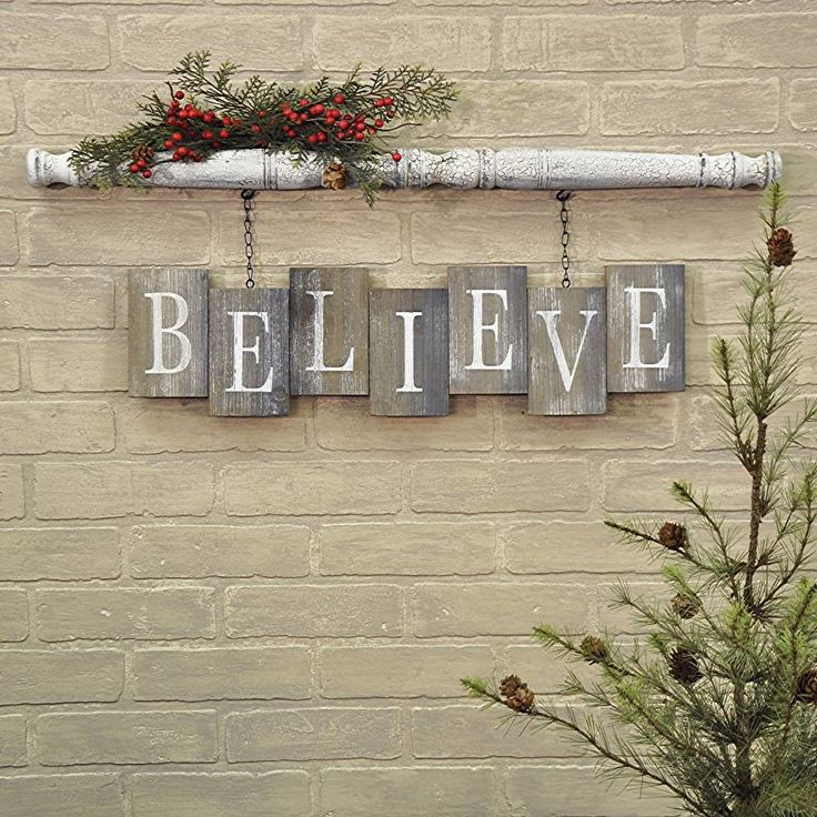 "Spindle has an antique white crackled paint finish Weathered and worn ""bricks"" of reclaimed wood White stencilled letters 10""H x 31""W x 1""D Two clips on the back of the spindle make this item easy to hang"