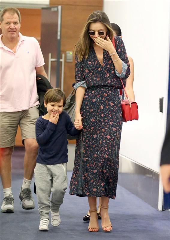 Miranda Kerr and son Flynn Bloom giggle as they arrive at Sydney Airport in Australia on Dec. 15, 2015.
