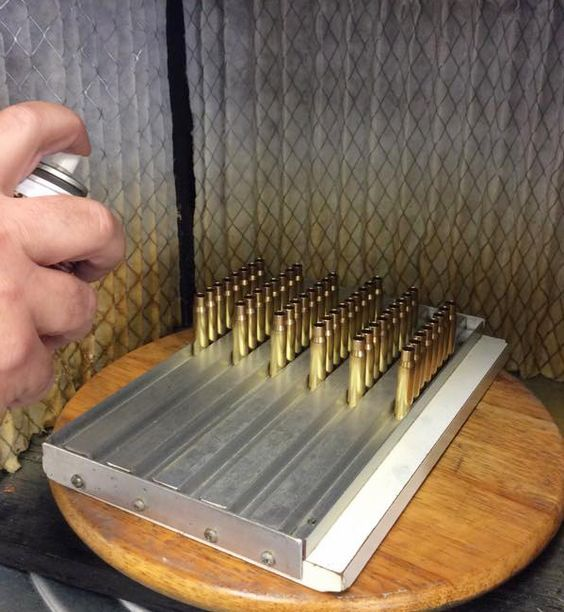 The U.S. AMU method for quickly applying sizing lube to cartridge cases.