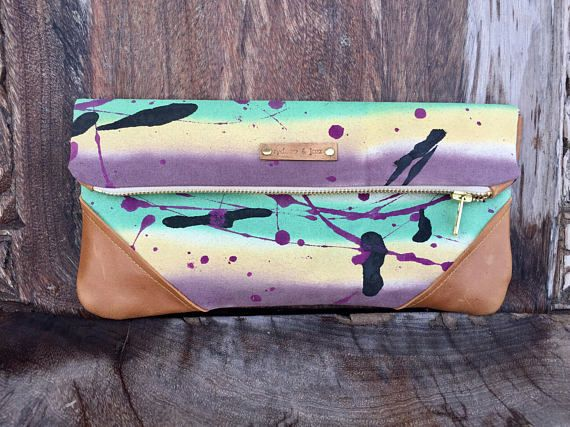 Mardi Gras handbag for 2018 carnival season. 100% genuine leather and hand painted linen. Each clutch comes with a 47 crossbody chain in gold tone. Ive only made a handful of these bags for this season. Once theyre gone theyre gone for good