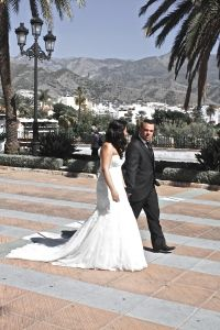 Bride & groom strolling down the aisle of the Balcon de Europa