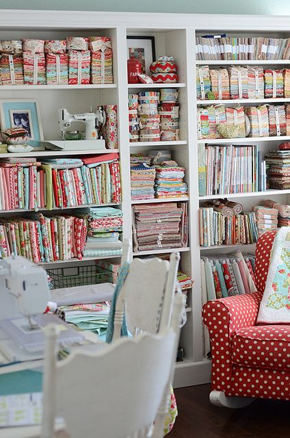 So I have a lot of friends who would love lots of things about this room - me, I want the red polk-a-dot chair on the far right, bottom corner. (sewing room by croskelley, via Flickr)