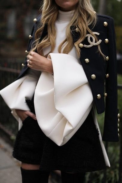 white top puffed sleeves jacket black jacket cropped jacket military style skirt mini skirt black skirt chanel brooch chanel