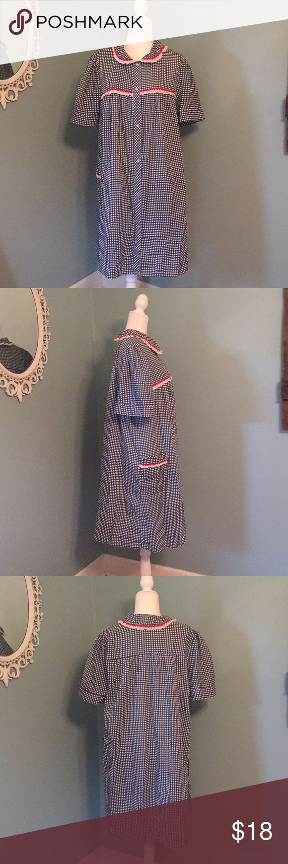 Retro Housecoat Blue and white check housecoast with red ric rac and white eyelet trim around the collar and on the two front pockets. Snaps up the front. This is labeled as a 2X, but runs really small. I wear a large and 12/14 and this fits me well. Ashley Taylor Intimates Intimates & Sleepwear Robes
