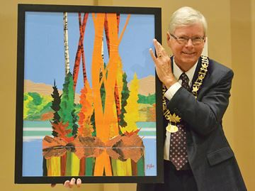 """Painting by late Midland artist Dennis Milton donated to town - Midland Mayor Gord McKay displays """"Sunlit Island"""" for the rest of council."""