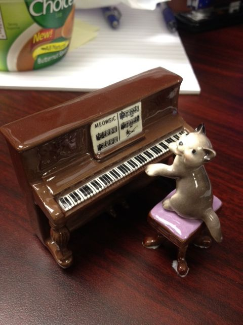 "One man's trash... This was posted on ""Why did you buy me that?"" aka, a site for crappy gifts. But I love this! It's a cat playing piano. What's not to love? <3"
