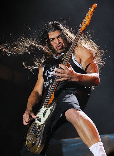 This is Robert Trujillo. The present bassist of Metallica He replaced Jason Newsted after he quit. He began playing bass for Metallica in 2003. ~Amberstar