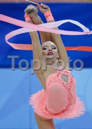 2244465 Russia, Kazan. 07/15/2013 Melitina Staniouta, Belarus, performs the ribbon routine during the finals of the rhythmic gymnastics individual all-around competition at the 27th World University Summer Games in Kazan. Konstantin Chalabov/RIA Novosti