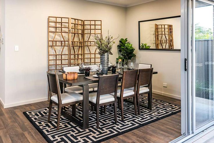 This gorgeous dining room is the ideal place to host sophisticated dinner parties. #weeksbuildinggroup #newhome #homedesign
