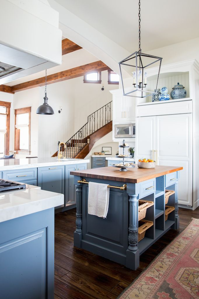 BECKI OWENS- Before and After: Heber House Project Kitchen in Collaboration with Jamie Bellessa.   Sharing details of this blue modern farmhouse kitchen with rustic industrial elements. We used Benjamin Moore Van Courtland Blue and Swiss Coffee, Calacatta marble with a mitered edge, brass Waterstone hardware, white farmhouse sink, white subway tile, the Darlana Lantern and Currey and Co Timpano pendents. Visit the blog for more details!