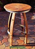 The Bartoli Petit Bistro Table has a smaller barrelhead top and is shorter than the original Bistro Table. The oak stave legs have a wide stance, which adds stability to the table. It has a galvanized steel rim around the top as well as the lower footrest.