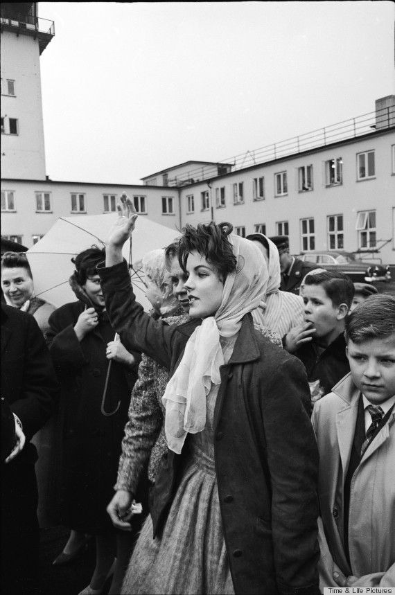 A young Priscilla Presley waves goodbye to Elvis in 1960. Time & Life Pictures/James Whitmore/Contributor..,