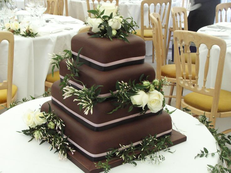 Square Chocolate Wedding with Jasmine and Roses decorated on each level