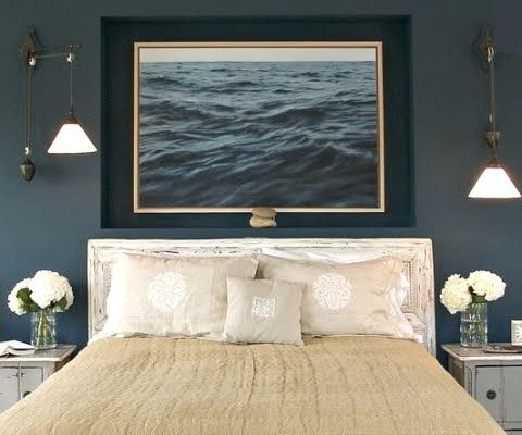 Dark blue walls and a photograph of the sea make this bedroom a sensuous  retreat and. Best 25  Girls nautical bedroom ideas on Pinterest   Dorm room
