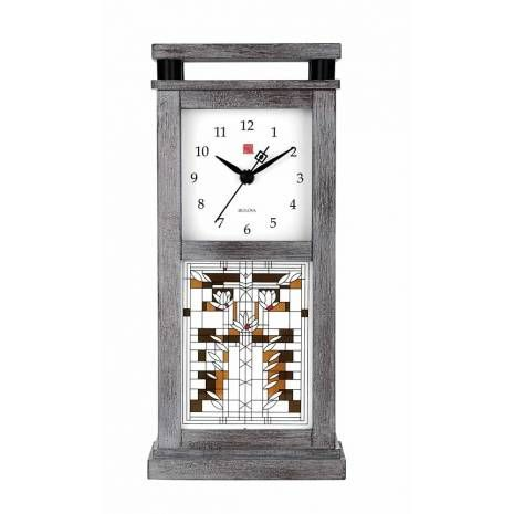 """Grey Oak Veneer Bulova Mantel Clock with Geometric Art Glass Waterlily Design The delicate stylized glass design of waterlilies, common in the tranquil ponds of the Midwest, is adapted from Frank Lloyd Wright's drawing """"Waterlilies,"""" which is thought to be designed for an art glass screen in 1895 but never produced. This early example epitomizes Wright's ability to incorporate themes from nature into his geometric designs and exemModernist Mantel Clock with Frank Lloyd Wright Waterlily…"""
