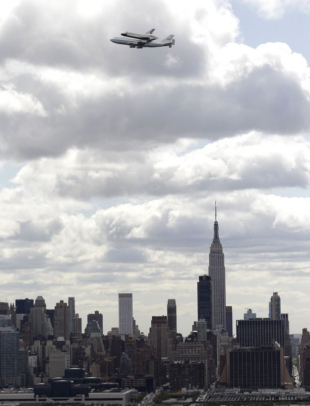 last flight of the Space Shuttle Enterprise (shown flying over NYC)