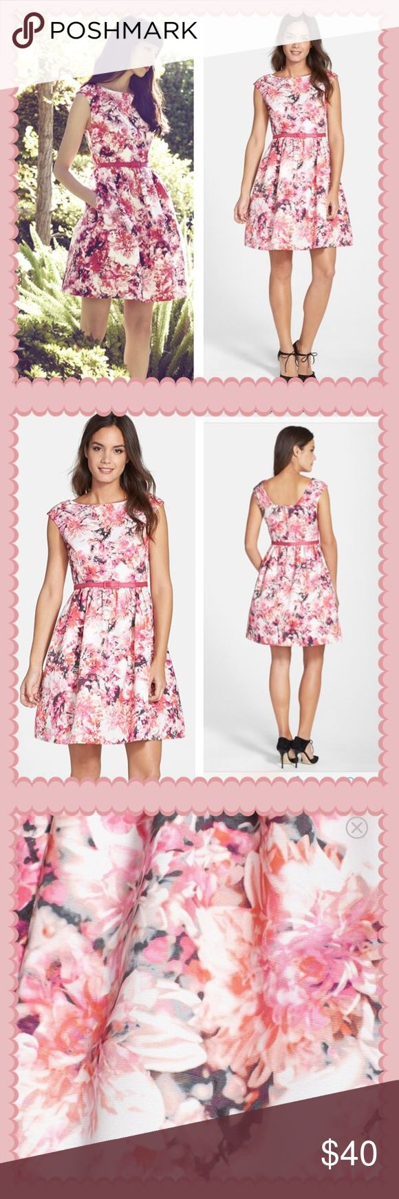 Eliza J Floral Fit & Flare Dress Soft pinks course throughout the hazy floral print and grosgrain-covered belt coordinating an ultrafemme cap-sleeve dress. Back zip closure. Fully lined. Front pockets. 100% polyester. Dry clean. By Eliza J; imported. Excellent condition.                                                   20% off bundles! Eliza J Dresses