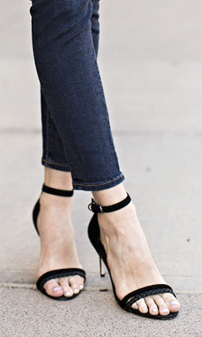 Soft suede black heels in a slender silhouette with a double strap front, one of which is beautifully braided