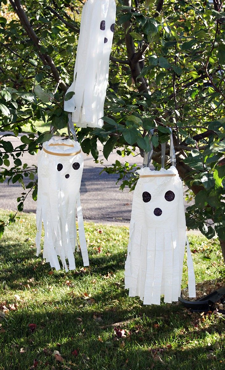 We love our spooky ghosts made out of Hefty Ultimate Flex Trash Bags - all you need is an embroidery hoop at the top, permanent marker for the eyes, and scissors to cut the ghostly fringe.