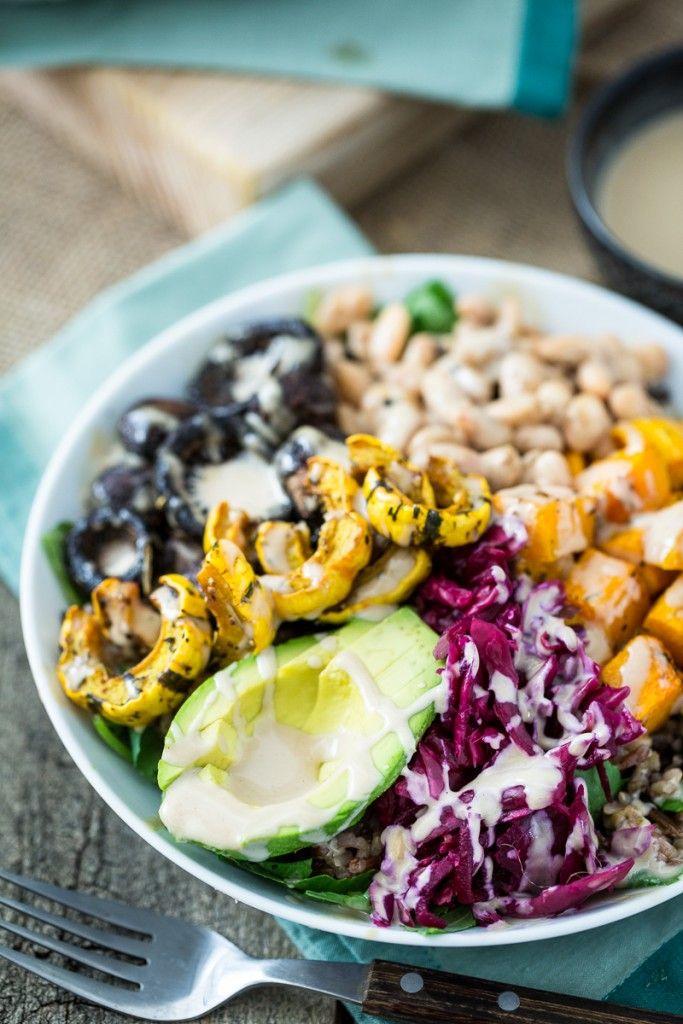 roasted rainbow winter bowl; mushrooms, butternut squash, delicata squash, white beans, wild rice, avocado, pickled red cabbage, and lemon tahini sauce.