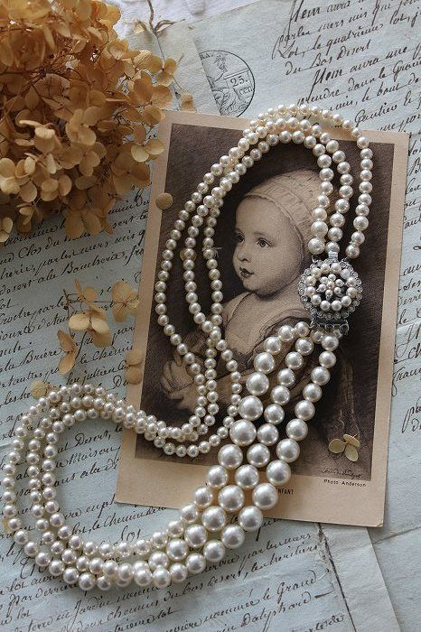 Vintage pearls....my mom wore these while gardening.....always ready to receive company