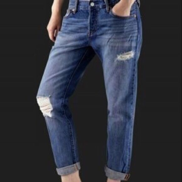 """NWT Levi's 501 CT Button Fly Boyfriend Fit Jeans Brand new with tags Levi's 501 CT Button Fly Custom Tapered Boyfriend Fit jeans. Medium blue, distressed/destroyed wash. Cotton. Women's size 30. They have a 10"""" rise and 28"""" inseam. Hard-to-find style! Levi's Jeans Boyfriend"""