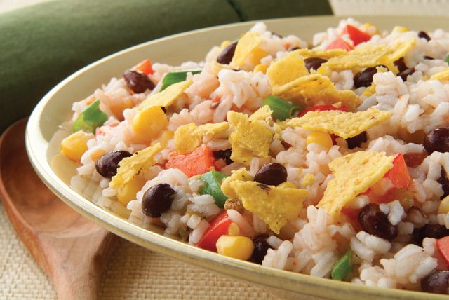 Why serve plain rice when you could make a spicy vegetable-rice salad with corn, beans, peppers and salsa?  The perfect side dish for warm weather entertaining.