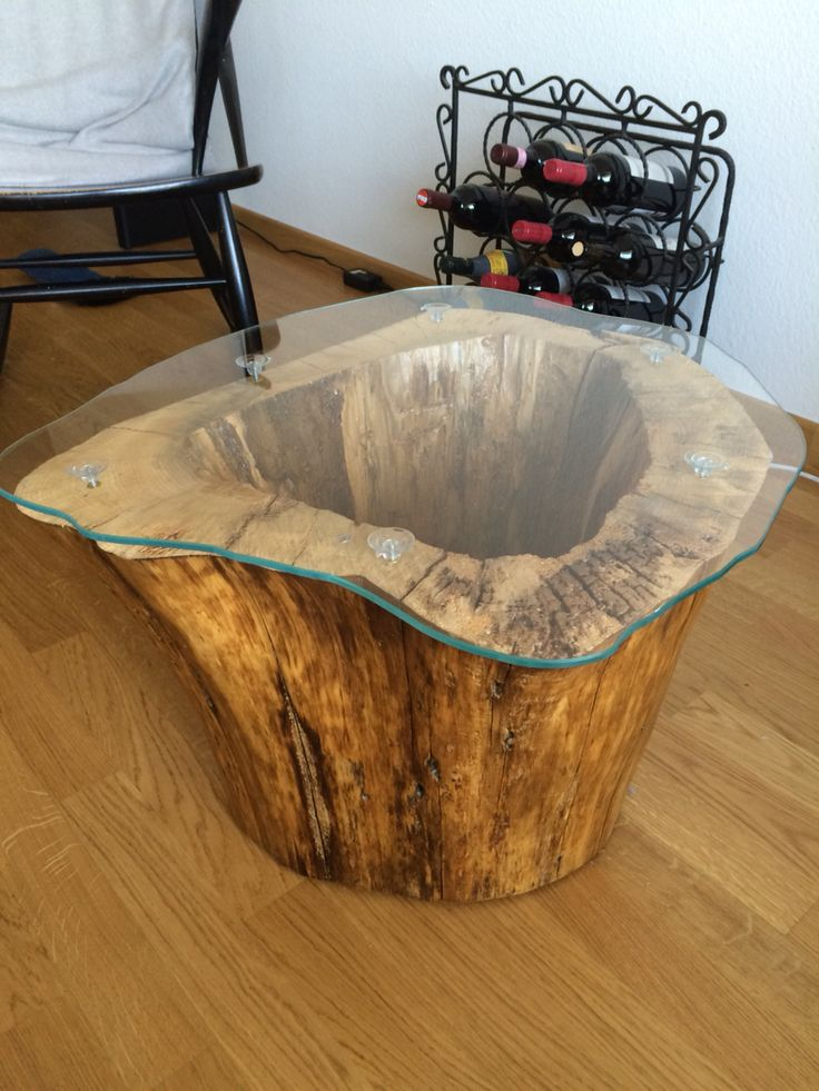 I made this coffee table with a lamp inside out of an old hollowed out tree stump. #coffeetable #furniture #tree stump