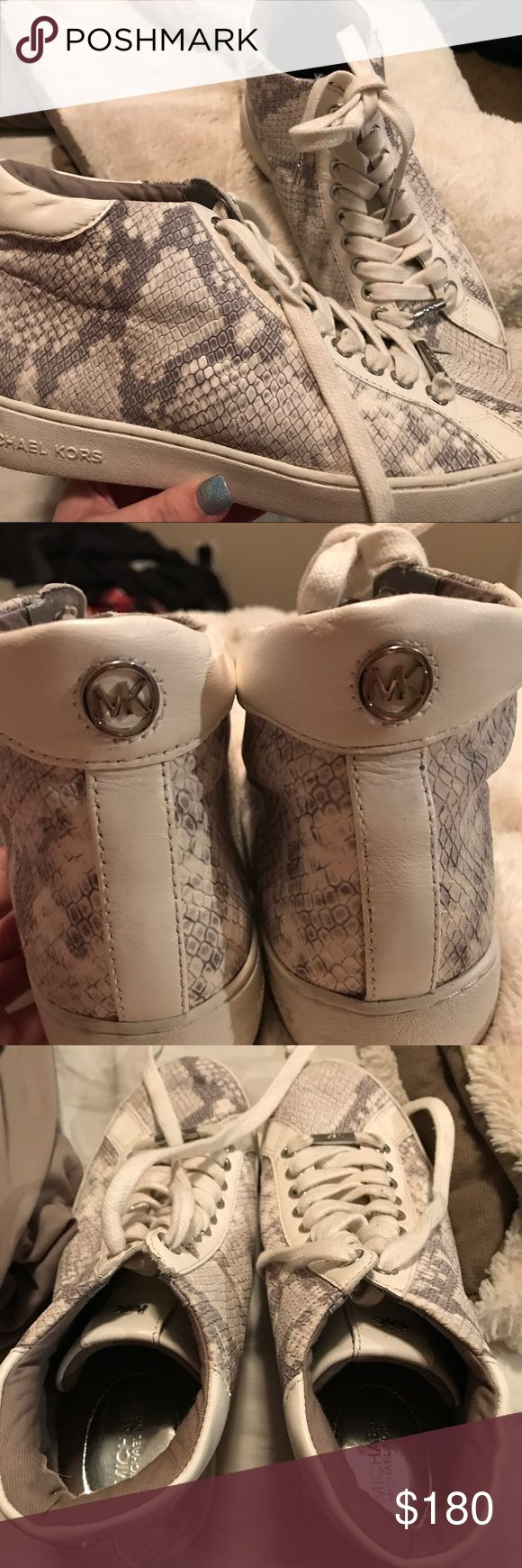 Michael Kors high-top tennis shoes White, high-top, only worn twice, excellent condition, VERY comfortable. A little marks on the shoe laces, and on the bottom/very back of the shoe but I will clean those off. Paid a lot at the Michael Kors store at Caesers Palace. Michael Kors Shoes Sneakers