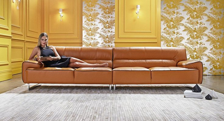 Downstairs living with matching armchair and ottoman Harper leather lounge